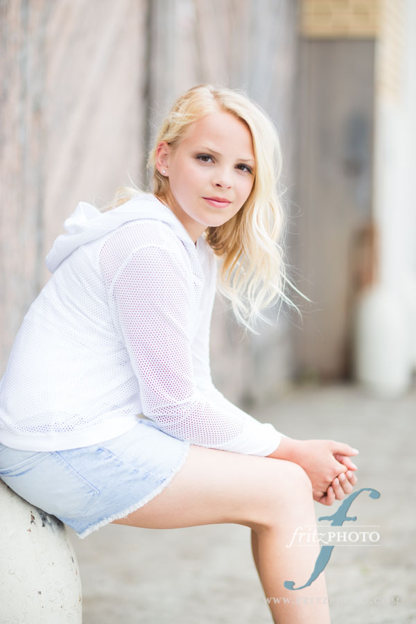 Blond girl child model sitting in Portland Oregon
