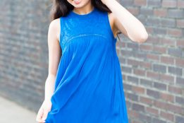 Cute young girl model in blue dress at portfolio photography session, Portland.