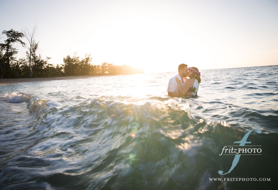 Portraits of a couple kissing in the waves in Hawaii