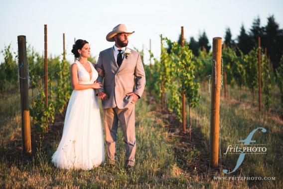 Portrait of bride and groom at sunset in vineyard outside of Salem Oregon