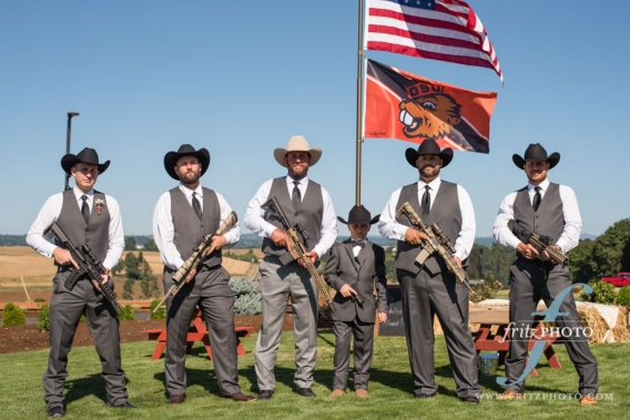 Funny groomsmen photo with guns