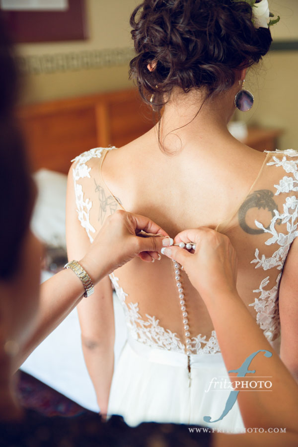 Photo of bride getting dressed at Edgefield