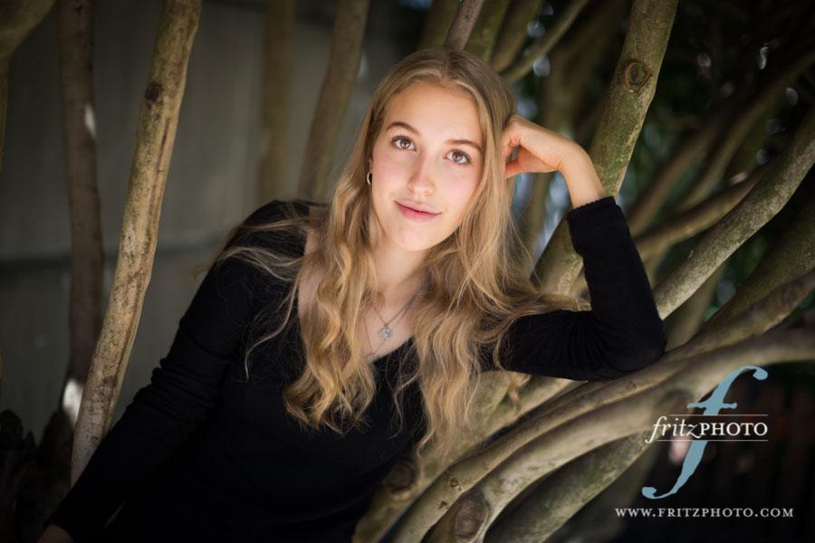 Senior portrait in rhododendron bush in NW Portland