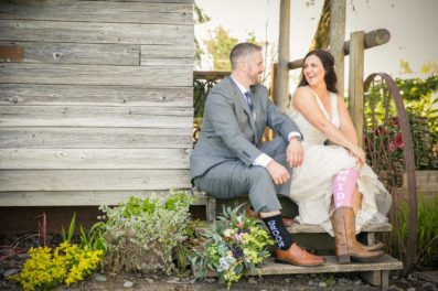 The bride wearing cowboy boots for her Postlewait's Wedding photographers