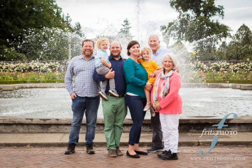 the whole family together for their family portraits at peninsula park in portland oregon