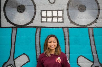high school senior portraits in front of murals