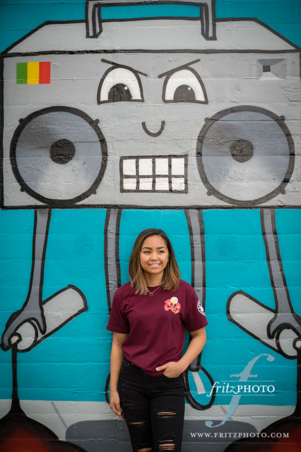 high school senior portraits in front of murals