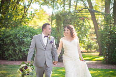 Bride and groom walking at Ainsworth House