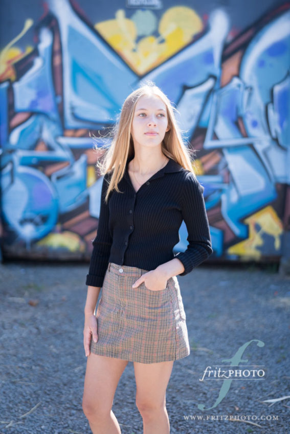 SE Portland senior photo of blond girl with graffiti