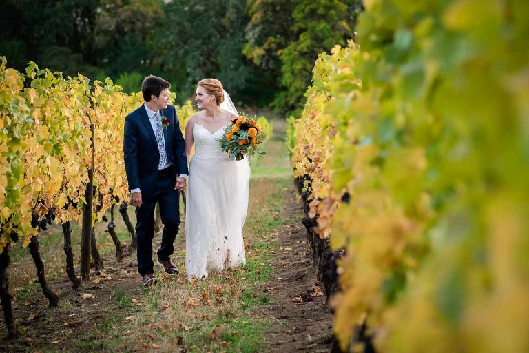 Portrait of bride and groom in the vineyard photographed at Youngberg Hill Vineyard and Inn