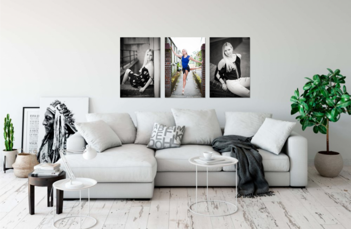 Portland senior portrait photos on a living room wall